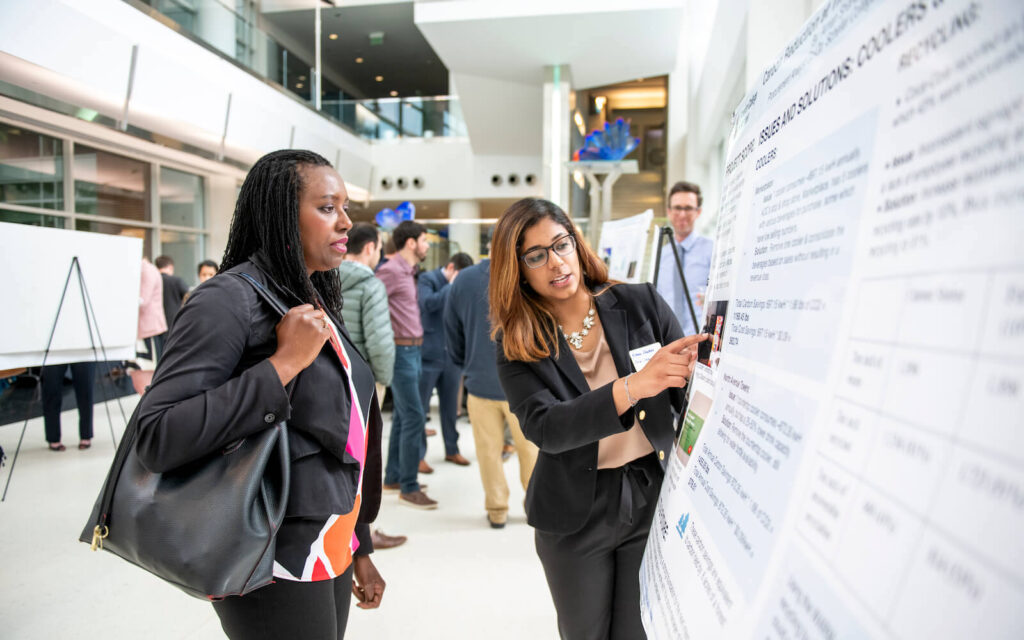 Student presents her poster at the Carbon Reduction Challenge Spring 2019